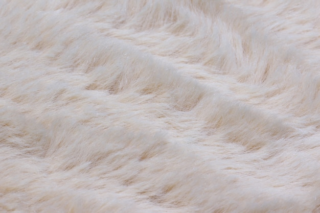Light long fiber soft fur white fur for background or texture fluffy fake textile fur flat lay