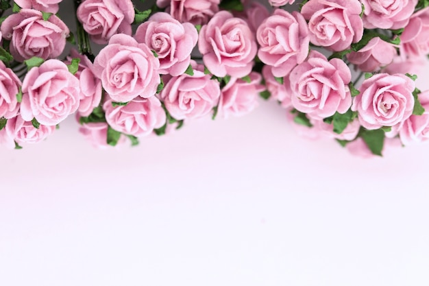 Light magenta roses in wood background