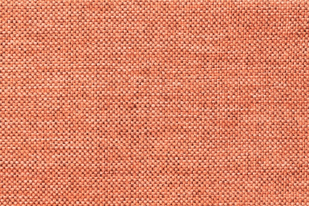Light orange background of dense woven bagging fabric of the textile