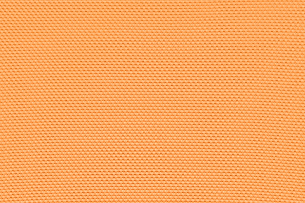 Light orange background from a textile material. perforated cloth backdrop.