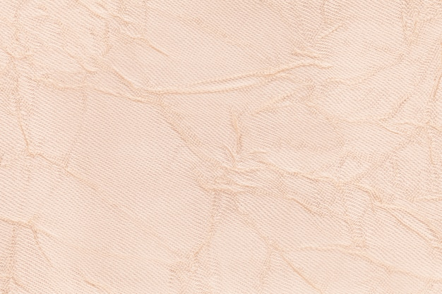 Light pearly wavy background from a textile material,
