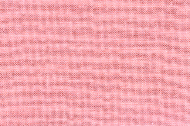 Light pink background from a textile material with wicker pattern
