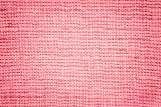 Light pink background from a textile material with wicker pattern,