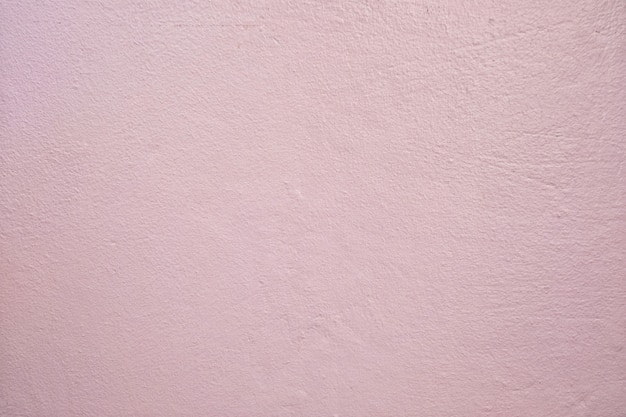 Light pink dirty cement wall background.