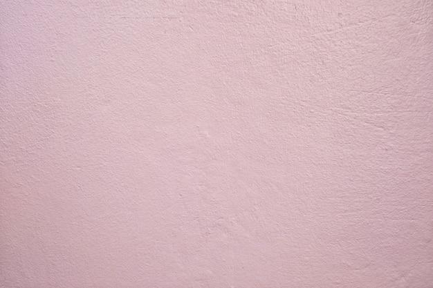 라이트 핑크 더러운 시멘트 벽 배경입니다.