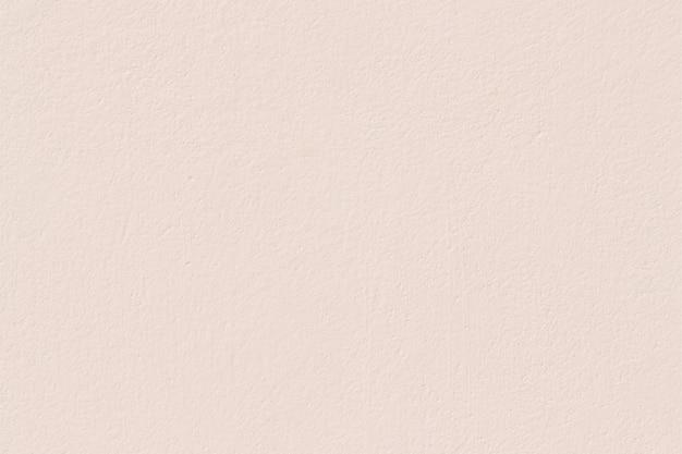 淡いピンクの漆喰壁の質感