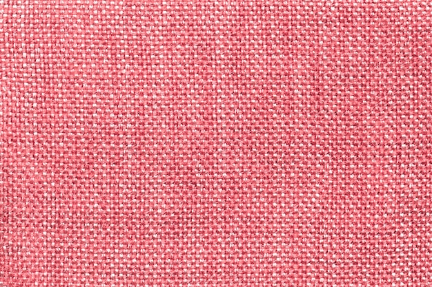 Light pink textile background with checkered pattern