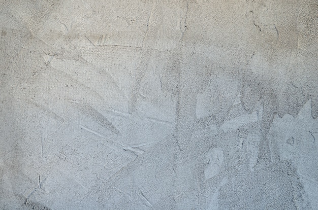 Light plaster wall with dirty scratched texture.