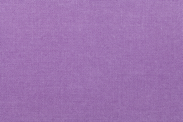 Light purple background from a textile material. fabric with natural texture. backdrop.
