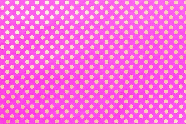 Light purple background from wrapping paper with a design of polka dot closeup.