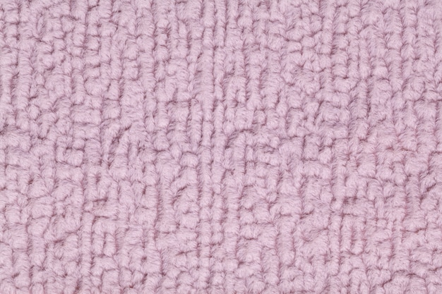 Light purple fluffy background of soft, fleecy cloth. texture of textile closeup.