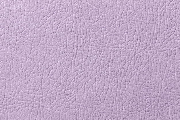 Light purple leather texture background, closeup. lilac cracked backdrop