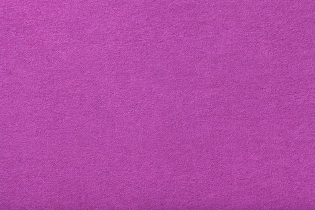 Light purple matt suede fabric closeup. velvet texture of felt.