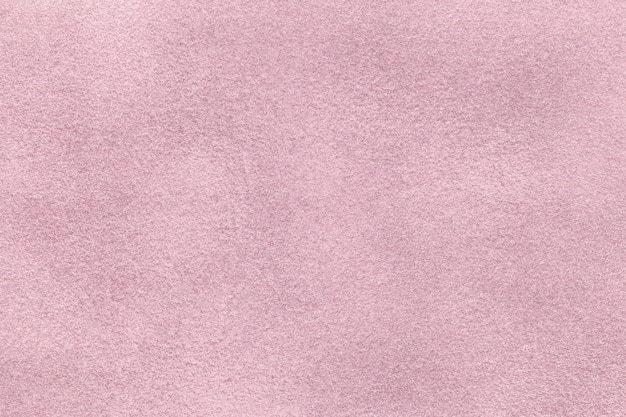 Light purple matte background of suede felt fabric, closeup. velvet texture of seamless lilac textile, macro.