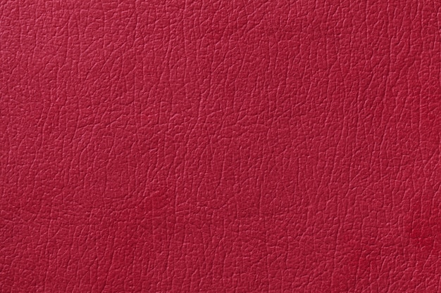 Light red leather texture background. closeup photo.