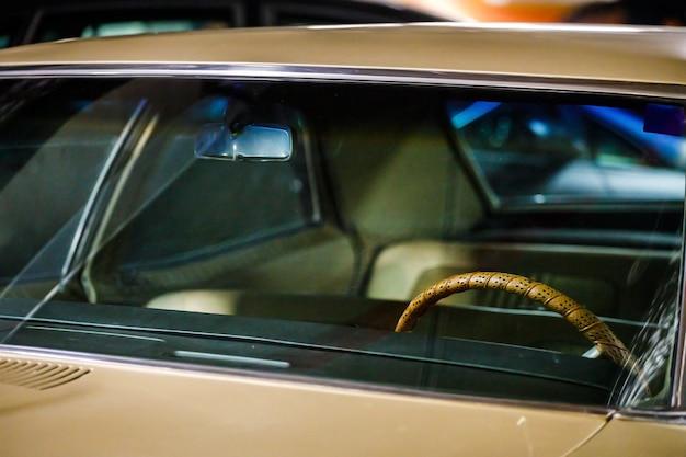 Light retro car close up. front view