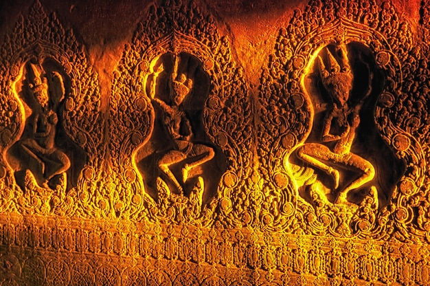The light of the rising sun, falling on the bas-reliefs of angkor wat