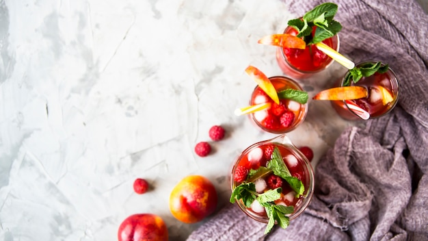 Light summer refreshing drink with fruits and berries - sangria
