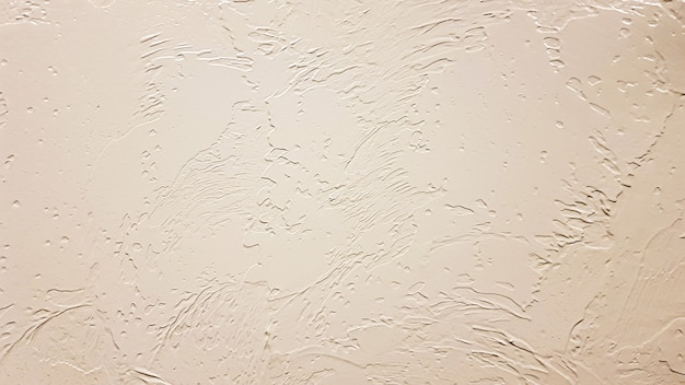 배경으로 가벼운 질감 석고입니다. 벽에 장식 석고 효과. 질감된 배경입니다. 장식용 석고 벽, 외관의 외부 장식. 베이지색의 질감입니다.