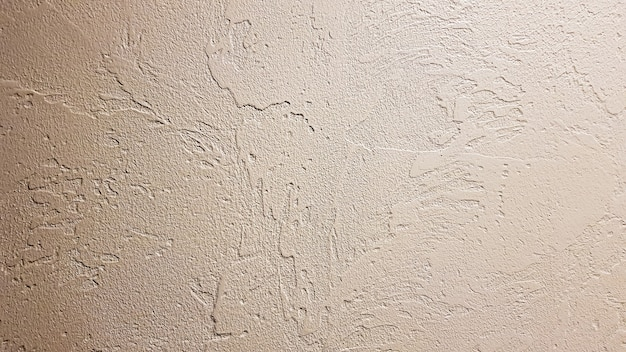 Light textured plaster as a background. decorative plaster effect on wall. textured background. decorative plaster walls, external decoration of facade. texture of beige.