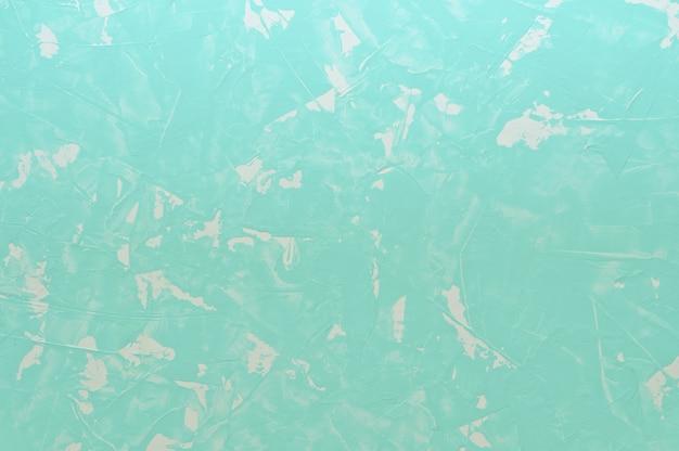 Light turquoise cracked concrete background