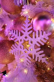 Light-up glitter snowflake and glitter ball shaped christmas ornaments in pink color light