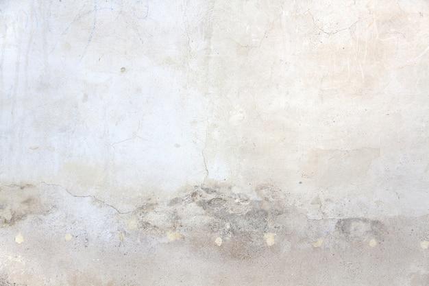汚れた灰色の斑点を持つ光の壁
