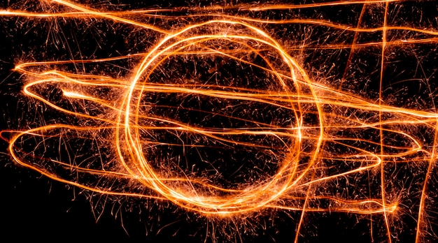 Light wave trail path, vibrant neon gold color in abstract swirls. light painting