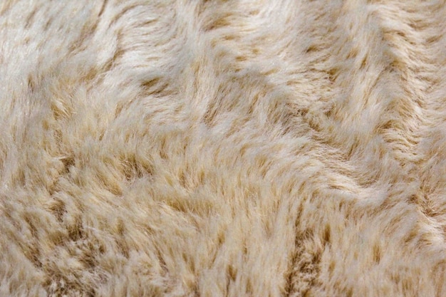 Light white long fiber soft fur. white fur for background or texture. fuzzy white fur plaid. shaggy blanket background. fluffy fake textile fur. flat lay, top view, copy space.