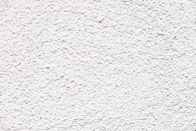 Светло белая стена крупным планом. детальная архитектура минималистский текстурированный фон с копией пространства. текстура белого окрашенного бетона. идеально белая поверхность. побелка стены. грубая чистая текстура.
