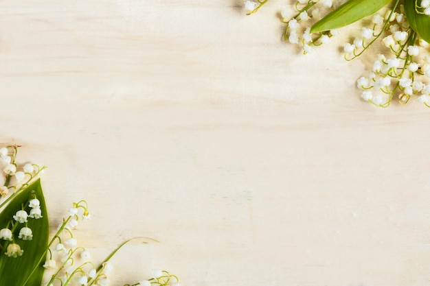 Light wooden background. flowers lilies of the valley.
