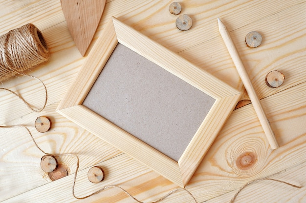 Light wooden frame on a wooden table. flat lay, top view photo