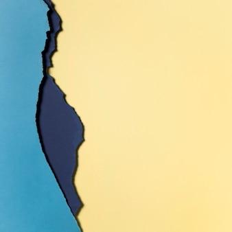 明るい黄色と青の紙の層