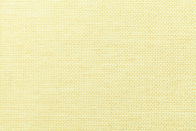 Light yellow background of dense woven bagging fabric, closeup. structure of the textile macro.