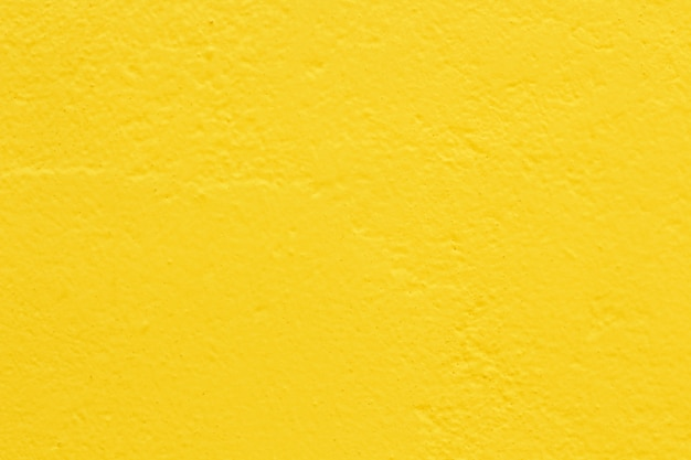 Light yellow color concrete wall texture for background and design art work.