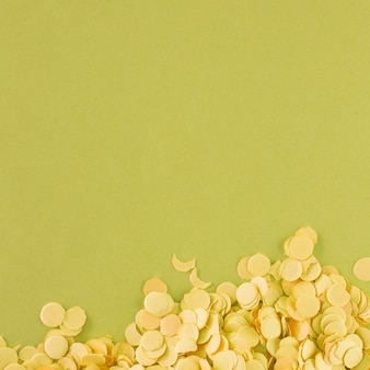 Light yellow confetti on green