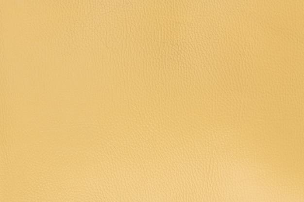 ミディアムグレインテクスチャ背景の薄黄色の滑らかなナチュラルレザー