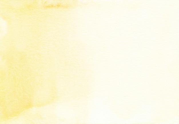 薄黄色の水彩表面の背景