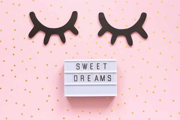 Lightbox text sweet dreams and decorative wooden black eyelashes