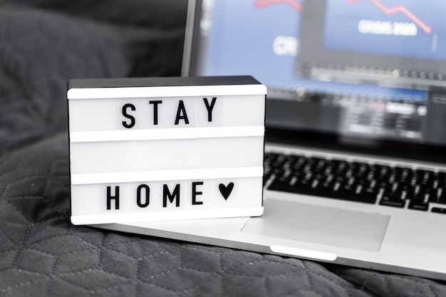 Lightbox with stay home text. top view flat lay covid-19 quote