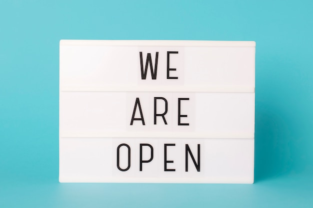 Lightbox with text message we are open