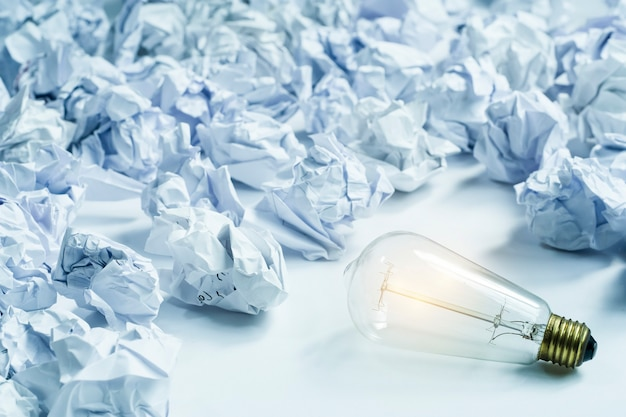 Lightbulb and paper crumpled