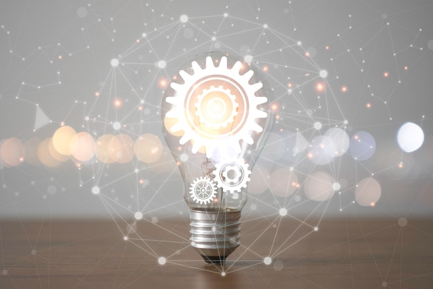 Lightbulb with cog gears and connection line. creative thinking idea concept.