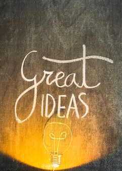 Lighted bulb on chalkboard with great ideas text