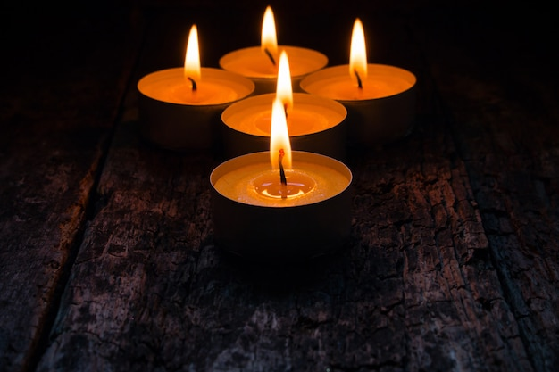 Lighted candles to relax on wood