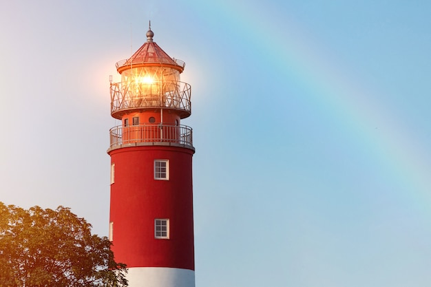 Lighthouse in baltiysk port. beautiful rainbow and beacon lights.