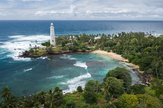 Lighthouse and beautiful beach landscape in sri lanka