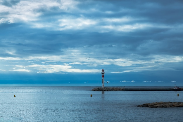 Lighthouse in cannes, french riviera. blue sky and calm water with beacon.