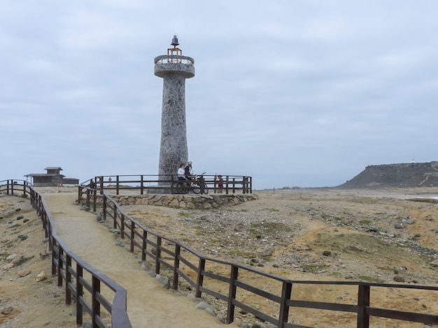 Lighthouse at the most western point in ecuador in a cloudy day