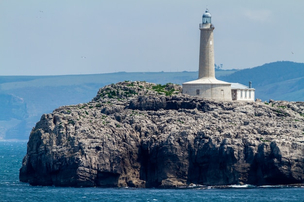 Lighthouse in  mouro island, santander, spain